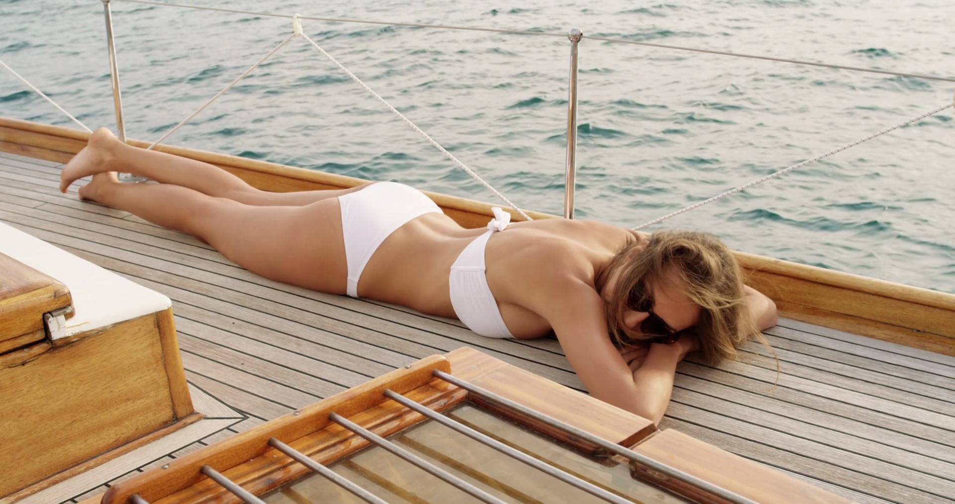 Bikini tanning woman