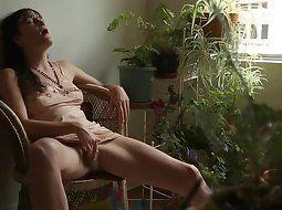 Masturbates on balcony
